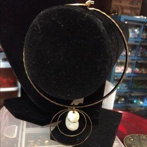 A bracelet w/ a solid circle, a stone & 2 circles